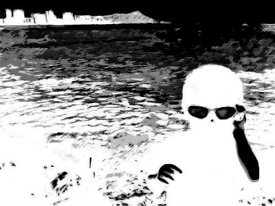 Black and white alien with distant landscape in background