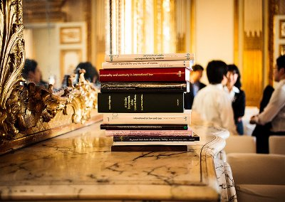 Stack of law books on a marble-topped side table in a Naples room.